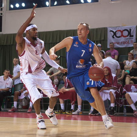 pbl: SAMARA, RUSSIA - MAY 11: Andrey Komarovskiy of BC Enisey with ball tries to go past a BC Krasnye Krylia player on May 11, 2013 in Samara, Russia.