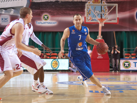 pbl: SAMARA, RUSSIA - MAY 11: Andrey Komarovskiy of BC Enisey, with ball, is on the attack during a BC Krasnye Krylia game on May 11, 2013 in Samara, Russia.