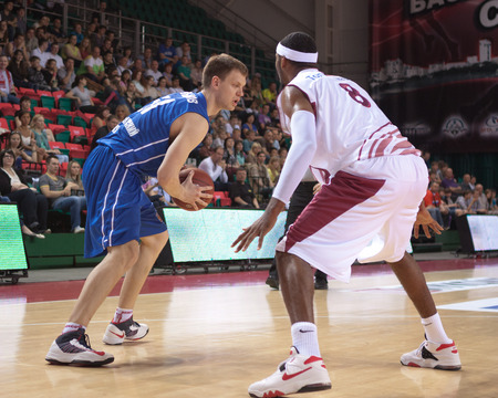 pbl: SAMARA, RUSSIA - MAY 11: Petr Gubanov of BC Enisey with ball tries to go past a BC Krasnye Krylia player on May 11, 2013 in Samara, Russia. Editorial