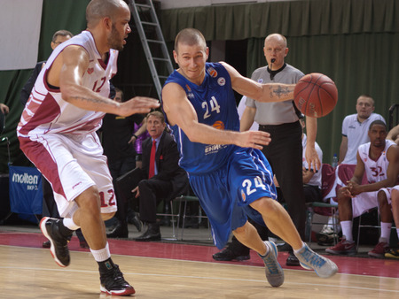 pbl: SAMARA, RUSSIA - MAY 11: Andrey Kuzemkin of BC Enisey with ball tries to go past a BC Krasnye Krylia player on May 11, 2013 in Samara, Russia.