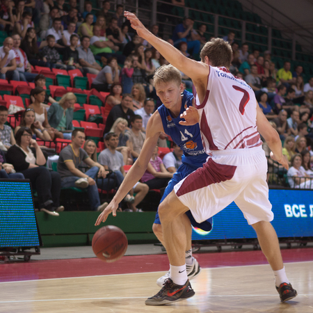 pbl: SAMARA, RUSSIA - MAY 11: Viacheslav Zaitcev of BC Enisey with ball tries to go past a BC Krasnye Krylia player on May 11, 2013 in Samara, Russia. Editorial