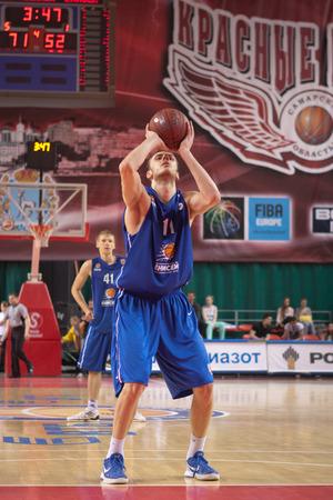 teammate: SAMARA, RUSSIA - MAY 11: Elmedin Kikanovic of BC Enisey throws from the free throw line in a game against BC Krasnye Krylia on May 11, 2013 in Samara, Russia.
