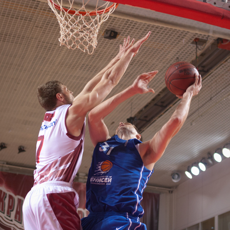 pbl: SAMARA, RUSSIA - MAY 11: Maxim Krivosheev of BC Enisey, with ball, is on the attack during a BC Krasnye Krylia game on May 11, 2013 in Samara, Russia.