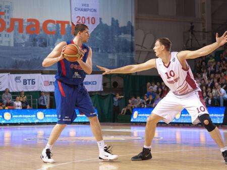 vasiliev: SAMARA, RUSSIA - MAY 19: Victor Khryapa of BC CSKA with ball goes against a BC Krasnye Krylia player on May 19, 2013 in Samara, Russia.