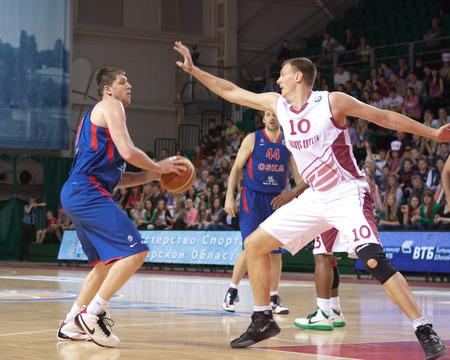 vasiliev: SAMARA, RUSSIA - MAY 19: Victor Khryapa of BC CSKA with ball tries to go past a BC Krasnye Krylia player on May 19, 2013 in Samara, Russia.