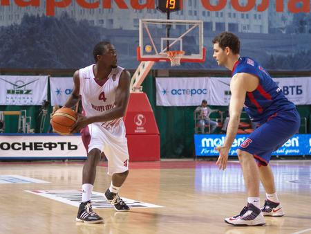 omar: SAMARA, RUSSIA - MAY 19: Omar Thomas of BC Krasnye Krylia with ball goes against a BC CSKA player on May 19, 2013 in Samara, Russia. Editorial