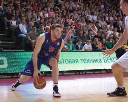 vasiliev: SAMARA, RUSSIA - MAY 19: Evgeny Voronov of BC CSKA, with ball, is on the attack during a BC Krasnye Krylia game on May 19, 2013 in Samara, Russia.