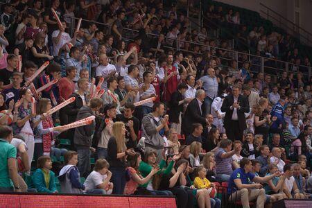 spectators: SAMARA, RUSSIA - MAY 19: Fans and spectators enjoyed on tribunes at the game between BC Krasnye Krylia and BC CSKA on May 19, 2013 in Samara, Russia. Editorial