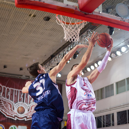 anton: SAMARA, RUSSIA - OCTOBER 22: Anton Pushkov of BC Krasnye Krylia throws the ball in a basket during a BC Triumph game on October 22, 2013 in Samara, Russia.