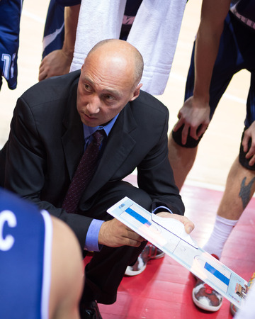 timeout: SAMARA, RUSSIA - OCTOBER 22: Timeout. Head coach of BC Triumph Vasiliy Karasev during a timeout of the game against BC Krasnye Krylia on October 22, 2013 in Samara, Russia.