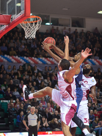 chappel: SAMARA, RUSSIA - OCTOBER 22: Evgeny Chebanenko and Julian Wright of BC Krasnye Krylia in the fight for the ball with Jeremy Chappell of BC Triumph on October 22, 2013 in Samara, Russia.
