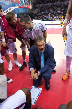 timeout: SAMARA, RUSSIA - OCTOBER 22: Timeout. Head coach of BC Krasnye Krylia Sergey Bazarevich during the BC Triumph basketball game on October 22, 2013 in Samara, Russia.