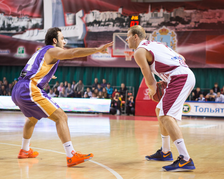 SAMARA, RUSSIA - NOVEMBER 06: BC Krasnye Krylia guard Anton Ponkrashov (7) with ball goes against a BC Royal Hali Gaziantep player on November 06, 2013 in Samara, Russia.