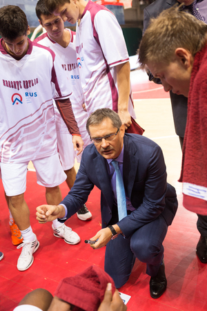 timeout: SAMARA, RUSSIA - NOVEMBER 06: Timeout. Head coach of BC Krasnye Krylia Sergey Bazarevich during a timeout of the BC Royal Hali Gaziantep basketball game on November 06, 2013 in Samara, Russia. Editorial