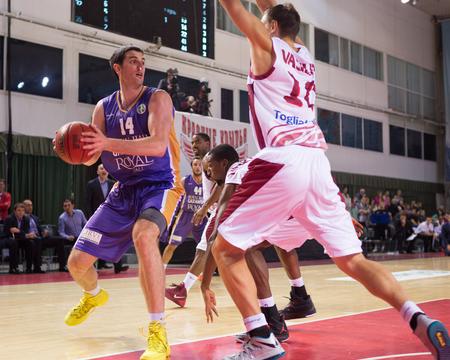 vasiliev: SAMARA, RUSSIA - NOVEMBER 06: BC Royal Hali Gaziantep forward Dejan Borovnjak (14) drives to the basket during the BC Krasnye Krylia game on November 06, 2013 in Samara, Russia. Editorial