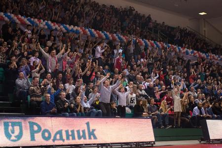 international basketball: SAMARA, RUSSIA - NOVEMBER 06: Fans and spectators enjoyed on the stand during the BC Krasnye Krylia and BC Royal Hali Gaziantep basketball game on November 06, 2013 in Samara, Russia.