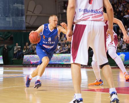 teammate: SAMARA, RUSSIA - NOVEMBER 09: BC Neptunas guard Mindaugas Gird�i?nas (8) drives to the basket during the BC Krasnye Krylia game on November 09, 2013 in Samara, Russia. Editorial