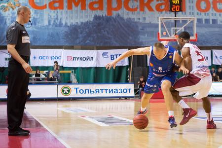 32: SAMARA, RUSSIA - NOVEMBER 09: BC Neptunas guard Mindaugas Girdziunas (8) fights for a loose ball with BC Krasnye Krylia guard Aaron Miles (32) during the BC Krasnye Krylia basketball game on November 09, 2013 in Samara, Russia. Editorial