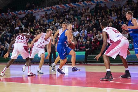 vasiliev: SAMARA, RUSSIA - NOVEMBER 09: BC Neptunas guard Martynas Mazeika (7) with ball goes against a BC Krasnye Krylia player on November 09, 2013 in Samara, Russia.
