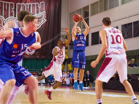 vasiliev: SAMARA, RUSSIA - NOVEMBER 09: BC Neptunas guard Arvydas Eitutavicius (13) goes up for a shot during the BC Krasnye Krylia basketball game on November 09, 2013 in Samara, Russia.