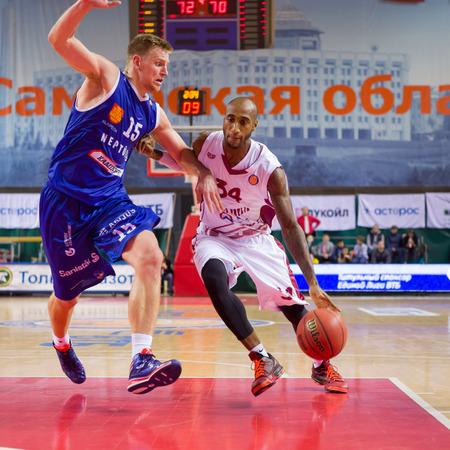 34: SAMARA, RUSSIA - NOVEMBER 09: BC Krasnye Krylia guard Bracey Wright (34) with ball tries to go past a BC Neptunas player on November 09, 2013 in Samara, Russia.