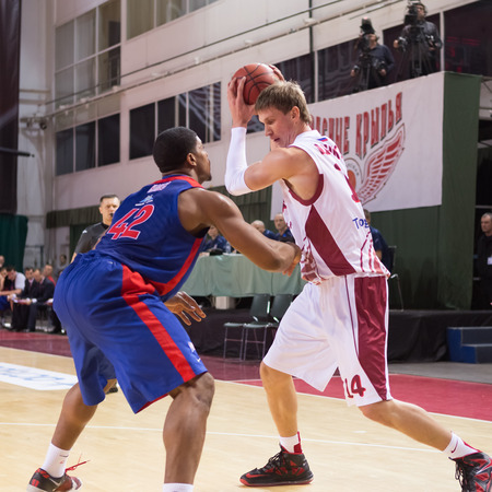 anton: SAMARA, RUSSIA � DECEMBER 01: BC Krasnye Krylia center Anton Pushkov (14) with ball goes against a BC CSKA player on December 01, 2013 in Samara, Russia.