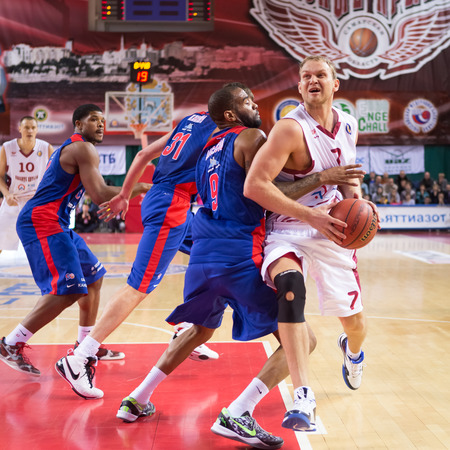 anton: SAMARA, RUSSIA � DECEMBER 01: BC Krasnye Krylia guard Anton Ponkrashov (7) with ball tries to go past a BC CSKA player on December 01, 2013 in Samara, Russia. Editorial