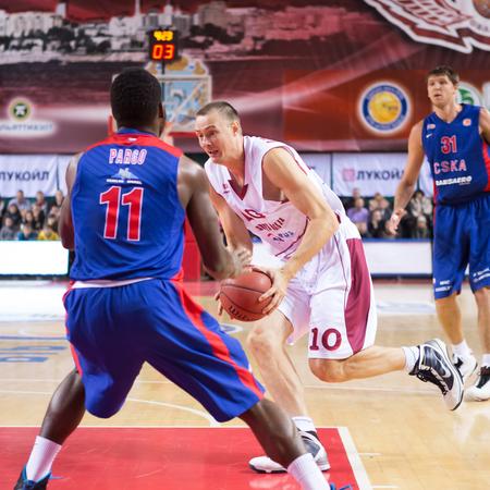 SAMARA, RUSSIA — DECEMBER 01: BC Krasnye Krylia forward Yuri Vasilyev (10) with ball goes against a BC CSKA player on December 01, 2013 in Samara, Russia.