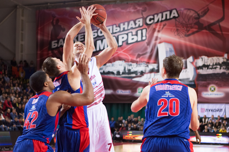 vitaly: SAMARA, RUSSIA DECEMBER 01: BC Krasnye Krylia guard Anton Ponkrashov (7) tries to make a shot in traffic during the BC CSKA basketball game on December 01, 2013 in Samara, Russia.