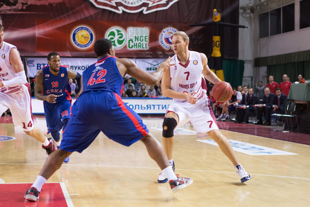 anton: SAMARA, RUSSIA — DECEMBER 01: BC Krasnye Krylia guard Anton Ponkrashov (7) with ball goes against a BC CSKA player on December 01, 2013 in Samara, Russia.