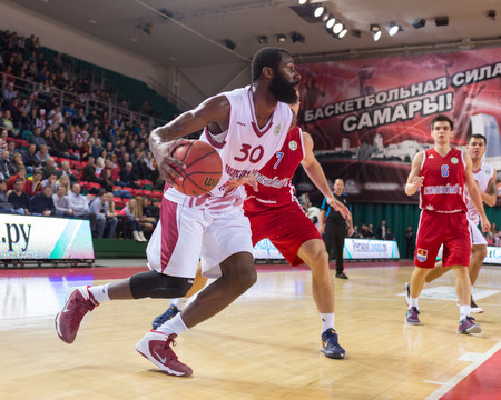 SAMARA, RUSSIA - DECEMBER 17: BC Krasnye Krylia forward Julian Wright #30 drives to the basket during the BC Atomeromu game on December 17, 2013 in Samara, Russia.