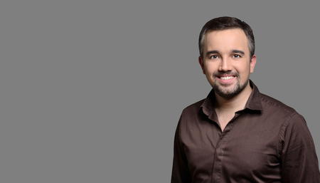 Beautiful dental smile, man portrait isolated on white background