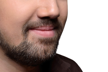 Man's beard on a cropped face isolated on white background
