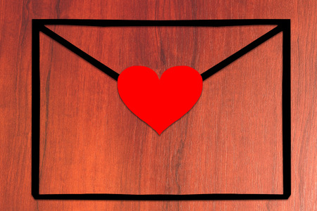 Empty envelope with heart on the table - stock photo