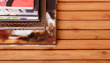 Different sizes  photobooks lay on wooden table Standard-Bild