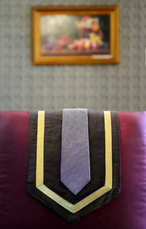The necktie lay on the back of the chair Standard-Bild