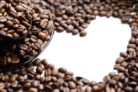 12 oclock: Cup of coffee beans isolated on white background