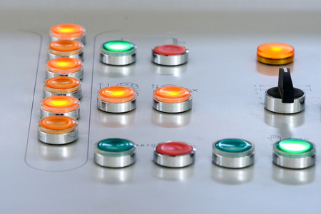 Buttons controls manufacturing process - stock photo Standard-Bild