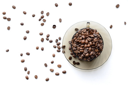 Cup of coffee beans isolated on white background
