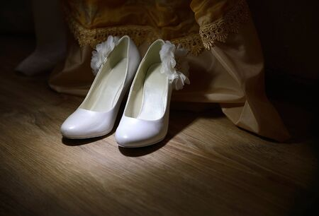 Bride's shoes. Wedding day details. Stock photo