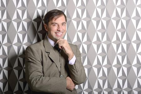 Business man standing near the wall