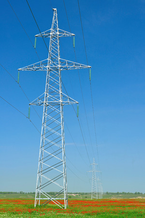 The high-voltage post on the papaverous field