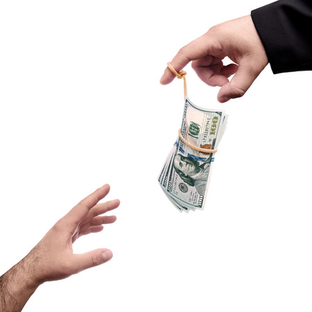 money on the fishing rod. Master of puppet hand holding money Standard-Bild