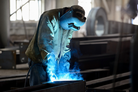 Heavy industry worker in action - stock photo