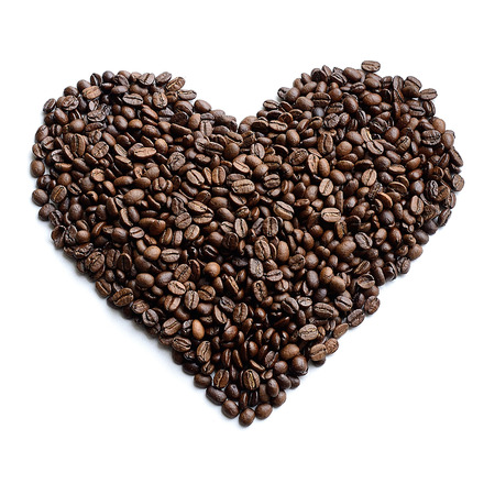 12 oclock: Heart made of coffee beans isolated on white background