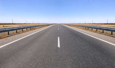 Highway. Country road and deep blue sky