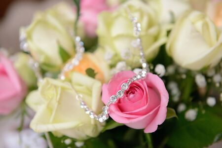 neckless: the neckless on the flower - stock photo
