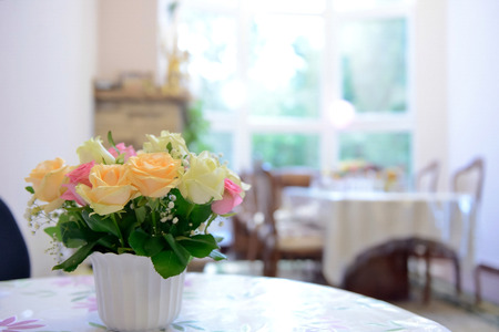 the bouquet of the flowers on the table. Blured background Standard-Bild