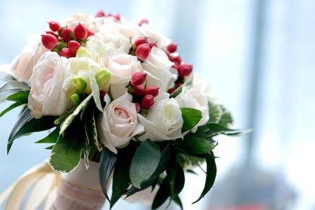 Bride's bouquet, blured blue background