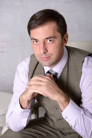 Business man sitting portrait